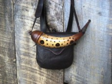 "Eric Fleisher Pouch and Art DeCamp HornHand stitched, 7"" by 7"" modified 'D' shaped pouch with a 1"" wide gusset made of 4 0z. vegetable tanned leather. Shown with an attached spotted Berks Co. screw tip powder horn made by Art DeCamp.Photo by Eric Fleisher"