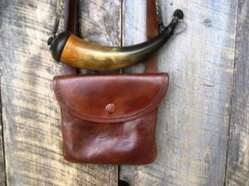 "Eric Fleisher Shot Pouch with a Sparks Mumma HornHand Stitched, 8"" by 7"" rectangular shaped pouch made of 4 0z. vegetable tanned leather. Shown with a powder horn made by Sparks Mumma. The horn is decorated with an engraved hunter shooting at a deer.Photo by Eric Fleisher"