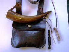 "Gary Elsenbeck Pouch and HornSimple powder horn and pouch inspired by Jim Webb's book, ""Sketches of Hunting Pouches, Powder Horns, and Accouterments of Southern Appalachia"".  Accompanying the combination is a handmade antler measure, a copper vent pick and a pan brush of turned blackwood and horse hair. Photo by Gary Elsenbeck"